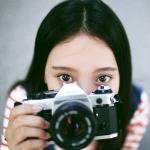 拿相机大眼女孩子头像图片